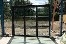 Bifold Door Fitted into Steel Frame