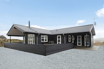 Black Timber House with White Windows